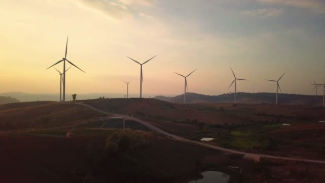 aerial view flying by drone of wind turbines - wind power stock videos and b-roll footage