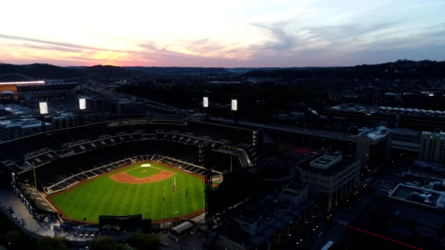 aerial view flying by pnc park at sunset in pittsburgh - pittsburgh video stock e b–roll