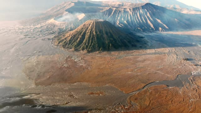 aerial view flying on active volcano at bromo tengger semeru national park, east java, indonesia - volcano stock videos & royalty-free footage