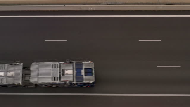 stockvideo's en b-roll-footage met aerial view flying over a highway in the basque town of guethary, france - tweebaansweg
