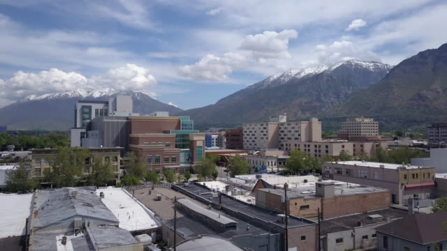 aerial view flying over buildings in downtown provo, utah - provo stock videos & royalty-free footage