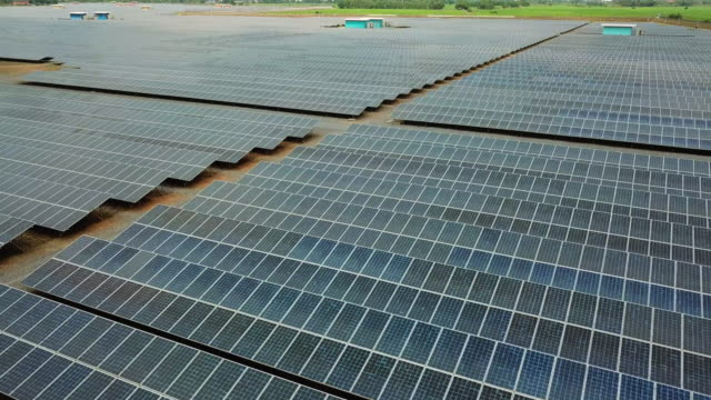 Aerial view flying over large solar farm