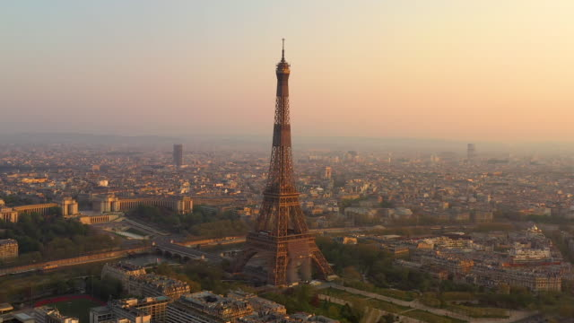 aerial view flying over paris france looking at the eiffel tower, sunrise - arc de triomphe paris stock videos & royalty-free footage