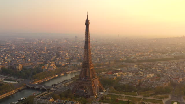aerial view flying over paris france looking at the eiffel tower, sunrise - eiffel tower paris stock videos & royalty-free footage