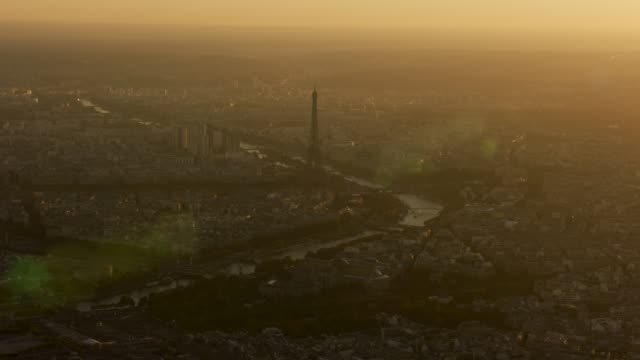 Aerial view flying over Paris France view of Eiffel Tower, sunset
