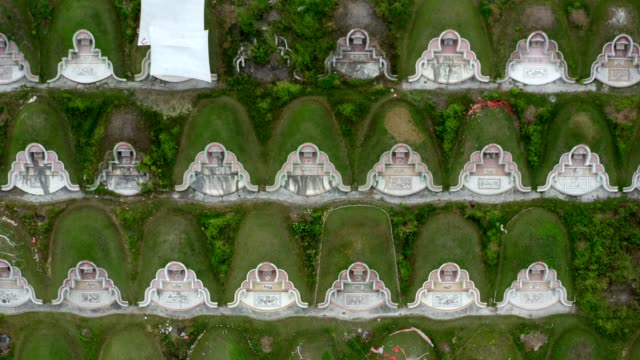 aerial view : flying over the cemetery on memorial day - gravestone stock videos & royalty-free footage