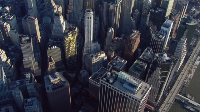 stockvideo's en b-roll-footage met aerial view flying over the skyscrapers of lower manhattan in new york city's financial district. - wall street lower manhattan