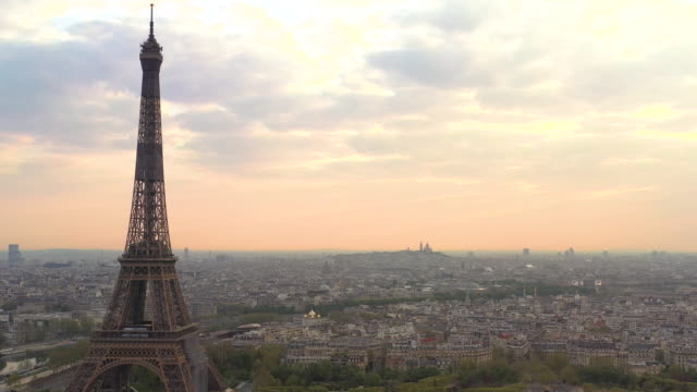 aerial view flying past the eiffel tower over paris france, sunrise - eiffel tower paris stock videos & royalty-free footage