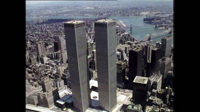 aerial view flying past the world trade centre towers; 1974 - manhattan financial district stock videos & royalty-free footage