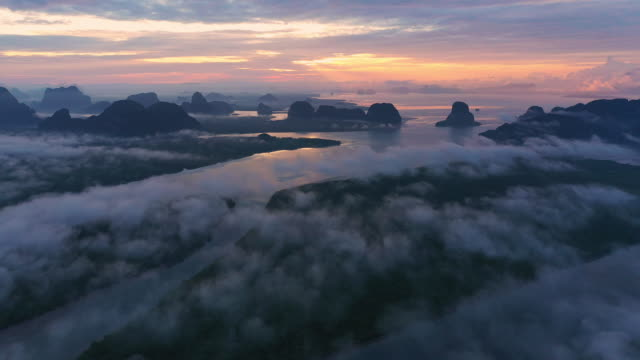 aerial view fog clouds pulling on morning at  phang-nga bay - morning dew stock videos & royalty-free footage