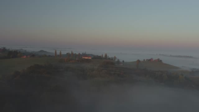 ws aerial view fog over tranquil rolling landscape,jeruzalem,slovenia - prekmurje stock videos & royalty-free footage