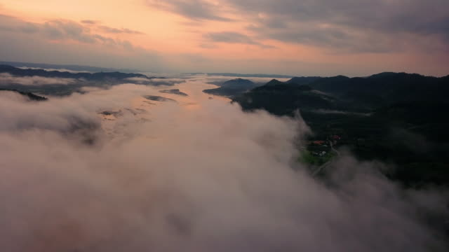 aerial view foggy in during sunrise and under clouds or mist this is mekong river. - laos stock videos & royalty-free footage