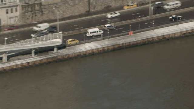 Aerial View Following New York City Taxi On FDR Drive Then Zooming Out