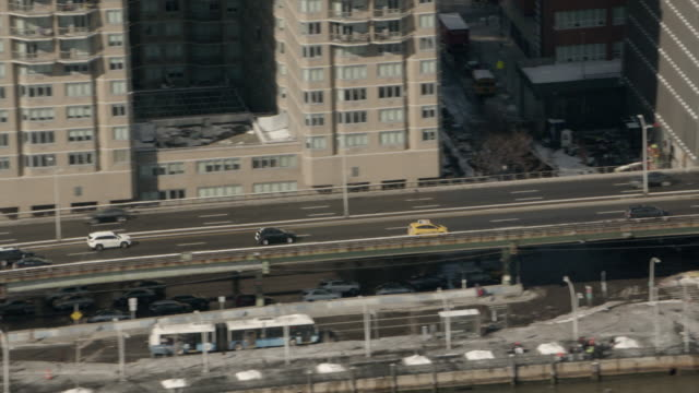 Aerial View Following New York City Taxi On The FDR Drive Northbound