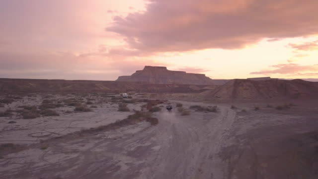 aerial view following ohv driving through the desert - exploration stock videos and b-roll footage