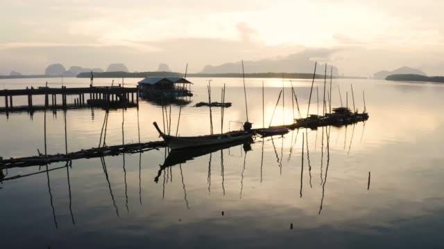 "4k aerial view footage of :sam chong tai"" fisherman village in phang nga, thailand. - longtail boat stock videos & royalty-free footage"