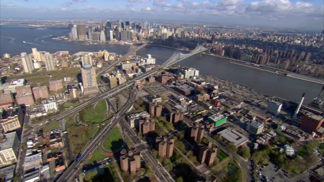 aerial view fort greene, downtown and dumbo, brooklyn past manhattan bridge / over brooklyn bridge to lower manhattan / new york city, new york - brooklyn bridge stock videos & royalty-free footage