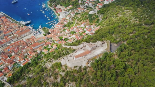 aerial view fortica fortress, town & bay in hvar - fort stock videos & royalty-free footage