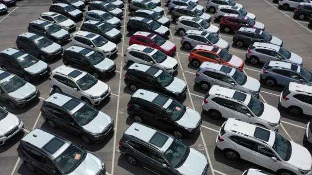 aerial view from a drone of brand new subaru cars sitting in an auto warehouse co. storage lot on april 30, 2020 in richmond, california. as people... - subaru stock videos & royalty-free footage