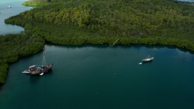 vidéos et rushes de aerial view from a drone over the bay of cyclones in le marin, martinique - french overseas territory