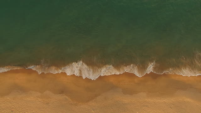 stockvideo's en b-roll-footage met aerial view from above of beautiful sea shore , waves and the sand with nobody - silvestre