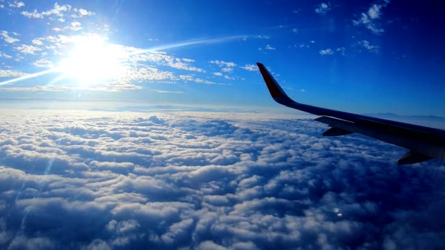 aerial view from airplane window flying above the cloud - aircraft wing stock videos & royalty-free footage