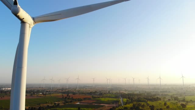 Aerial view from drone horizontal axis wind turbine with blue sky