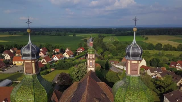 Aerial view from drone to the big abbey-church. Flying around and between the towers.