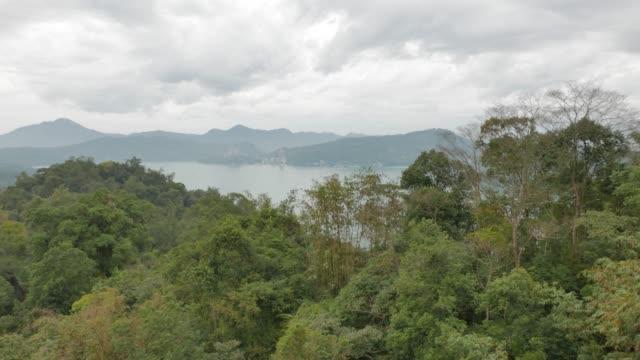 aerial view from gondola lift, sun moon lake, taiwan - sun moon lake stock videos and b-roll footage