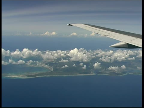 MS Aerial view from plane across clouds over Zanzibar island