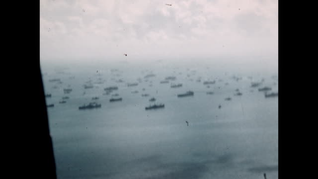 aerial view from plane as it flies over tokyo harbor and the uss missouri and other us navy ships where the surrender of the imperial japanese army... - surrendering stock videos & royalty-free footage