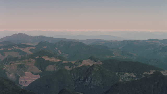 aerial view from plane over majestic green mountains. - majestic stock videos & royalty-free footage