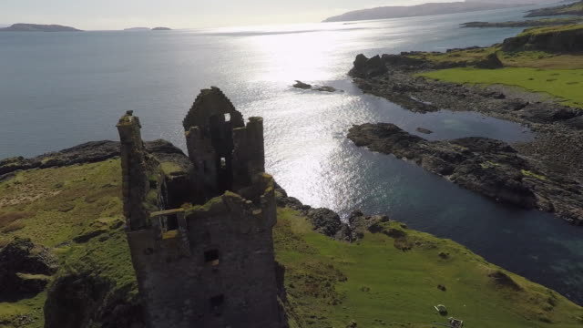 aerial view from top of gylen castle in kerrera scotland, with valley and coastline - scotland stock videos & royalty-free footage