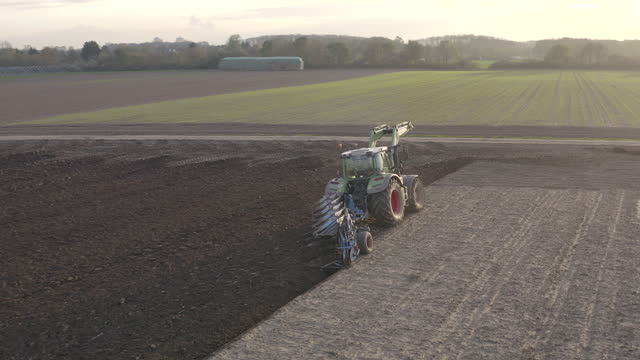 aerial view from tractor plowing the land in germany countryside - plough stock videos & royalty-free footage