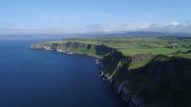 aerial view green antrim coastline, ireland - northern ireland stock videos & royalty-free footage