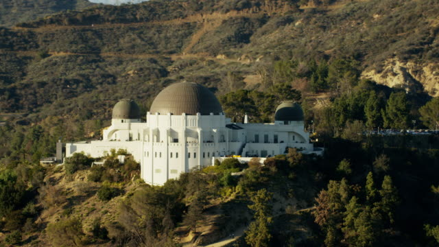 aerial view griffith observatory and los angeles suburbs - museum stock videos & royalty-free footage