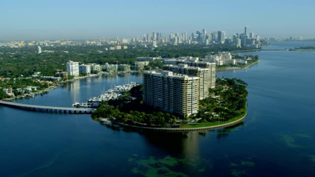 stockvideo's en b-roll-footage met aerial view grove isle hotel biscayne bay florida - biscayne bay