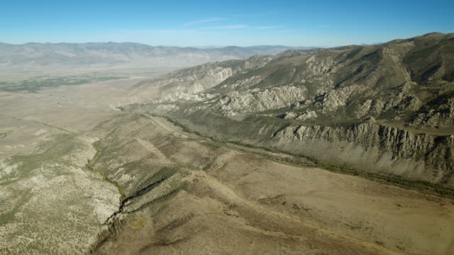 aerial view, heading into the eastern sierra nevadas from the town of bishop, inyo county, california. - basin and range province stock videos and b-roll footage