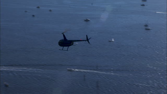 aerial view helicopter with pilot flying usa - propeller stock videos & royalty-free footage