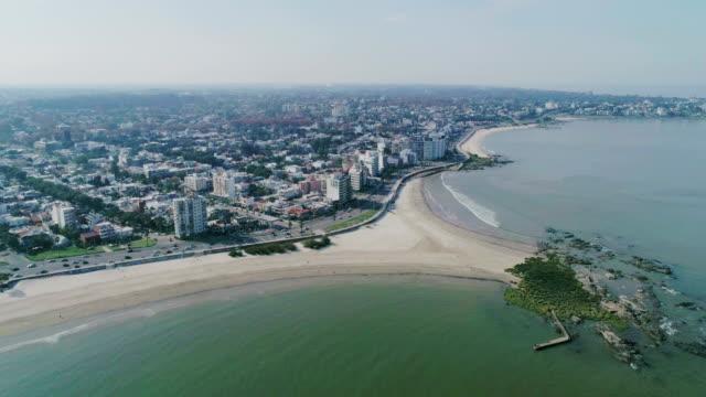 aerial view, high angle view, malvin beach and neighbourhood, montevideo's coastline, uruguay - sedative stock videos & royalty-free footage