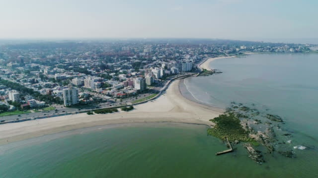 aerial view, high angle view, malvin beach and neighbourhood, montevideo's coastline, uruguay - rio de la plata stock videos & royalty-free footage