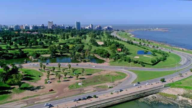 aerial view, high angle view, paragliding over montevideo's coastline, uruguay - montevideo stock-videos und b-roll-filmmaterial