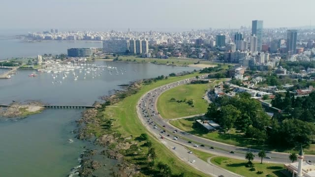 aerial view, high angle view, puertito del buceo neighbourhood, montevideo's coastline, uruguay - montevideo stock-videos und b-roll-filmmaterial