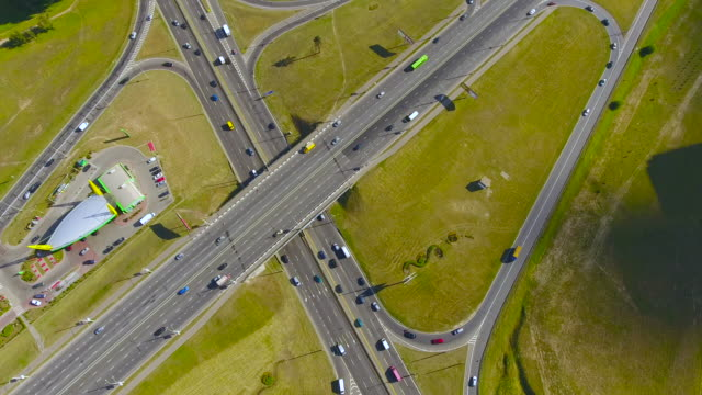 Aerial view highway, freeway, urban city transportation. Rush Hour. Cars Passing