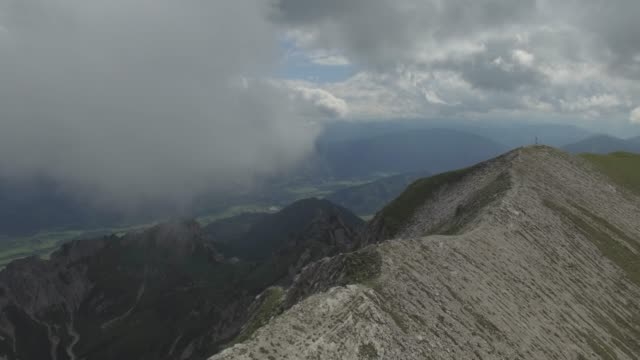 aerial view - hiker / climber on top of the mountain - pinaceae stock videos & royalty-free footage