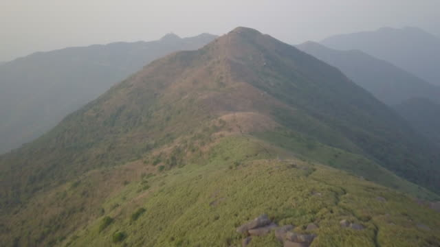 aerial view hong kong from air at sunset on top lion mountain - lantau stock videos and b-roll footage