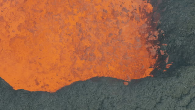 Aerial view hot lava rock forming on landing