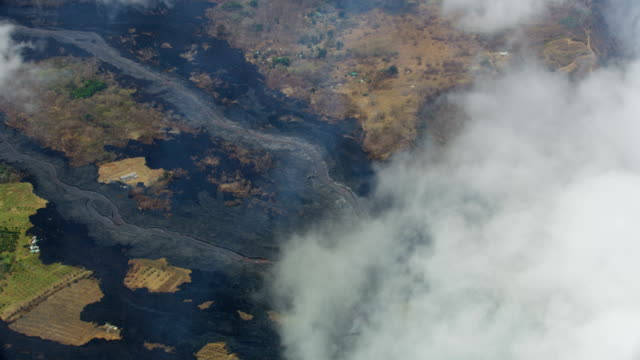 aerial view hot magma pouring from open fissures - tectonic stock videos & royalty-free footage