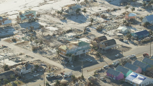 aerial view hotel condominiums destroyed by hurricane michael - wrack stock-videos und b-roll-filmmaterial