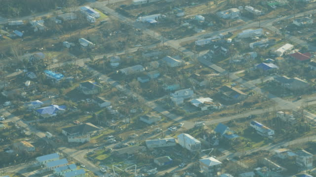 Aerial view hurricane damaged property rooftops Florida Panhandle